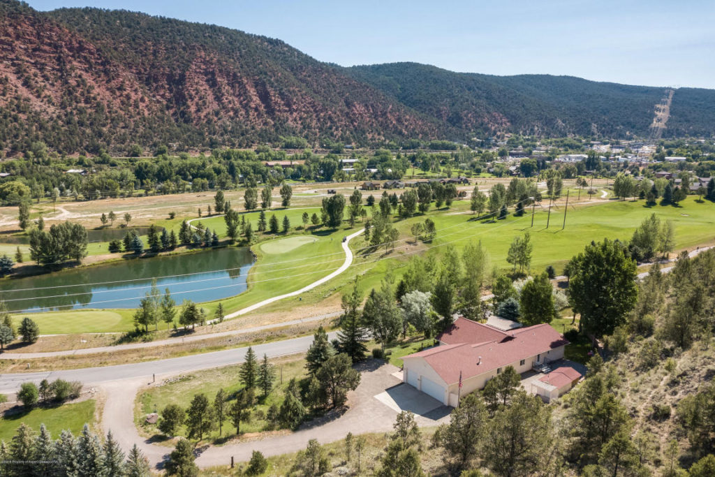 Custom ranch style home with open floor plan. Overlooking Iron Bridge Golf Course